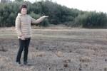 農業塾で使用する農地の前で…塾長の佐野すま子さん